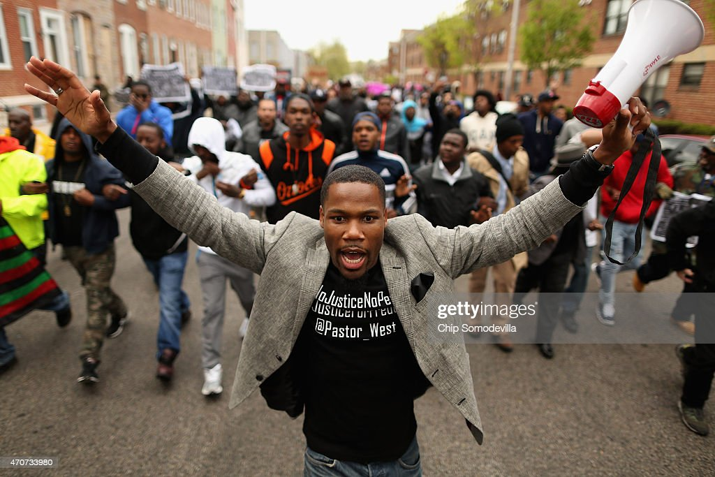 Hundreds of demonstrators march toward the Baltimore Police Western District station during a protest against police brutality and the death of Freddie Gray in the Sandtown neighborhood April 22, 2015 in Baltimore, Maryland. Gray, 25, was arrested for possessing a switch blade knife April 12 outside the Gilmor Homes housing project on Baltimore's west side. According to his attorney, Gray died a week later in the hospital from a severe spinal cord injury he received while in police custody.