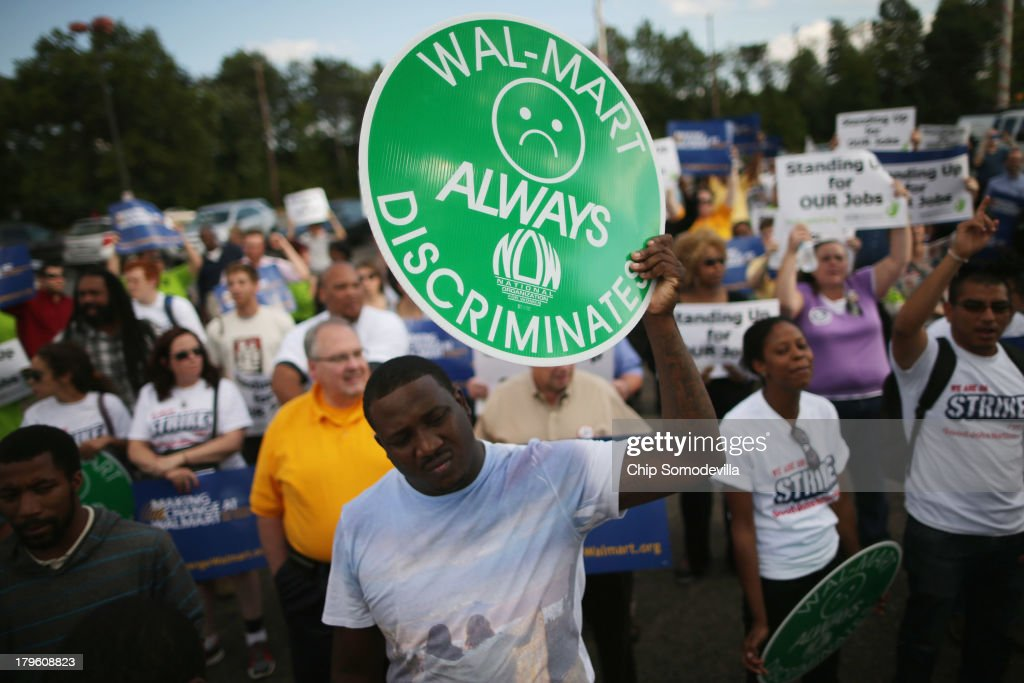 Hundreds of demonstrators rally before marching and blocking traffic in a major intersection outside a Walmart store during rush hour September 5, 2013 in Hyattsville, Maryland. Six women were arrested during the demonstration where about 225 people gathered outside the Walmart store to protest the retail giant's labor practices. A showdown continues between Walmart and the neighboring District of Columbia, where Mayor Vincent Gray could sign a bill that would make large retailers to pay their employees a 50 percent premium over the city's minimum wage.