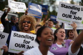 Hundreds of demonstrators rally before marching and blocking traffic in a major intersection outside a Walmart store during rush hour September 5...
