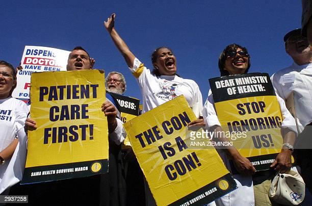 Hundreds of doctors dentists and nurses marched through the streets of Cape Town 06 February 2004 to protest against poor salaries and working...