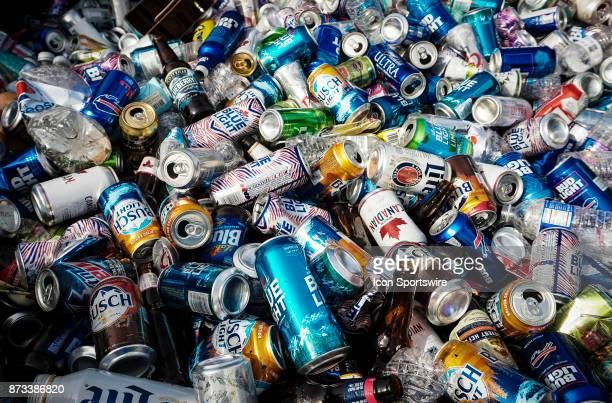 Hundreds of empty beer cans in the bed of a pickup truck as Buffalo Bills fans tailgate at the Hammer's Lot at the Pinto Ron tailgate party before...