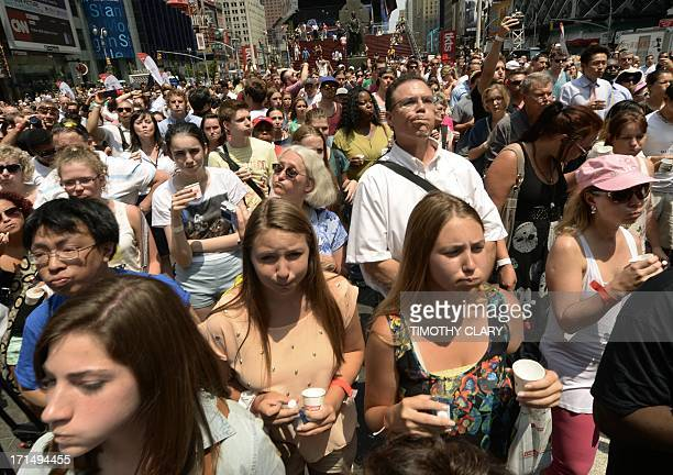 Hundreds of eople rinse their mouths with mouthwash in Times Square in New York June 25 2013 where over 1200 participants set a Guinness World Record...
