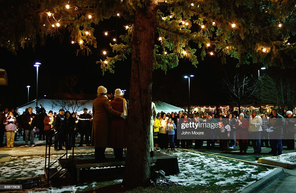 Hundreds of family members sing 'Silent Night' at a Christmas tree lighting ceremony to honor loved ones who spent their final days at the Hospice of Saint John on December 4, 2009 in Lakewood, Colorado. The non-profit hospice holds an annual ceremony where the names of those who have passed away while at the hospice are read aloud.The hospice accepts patients regardless of their ability to pay, although most are covered by Medicare or Medicaid. End-of-life care has become a contentious issue in the current national debate on health care reform.