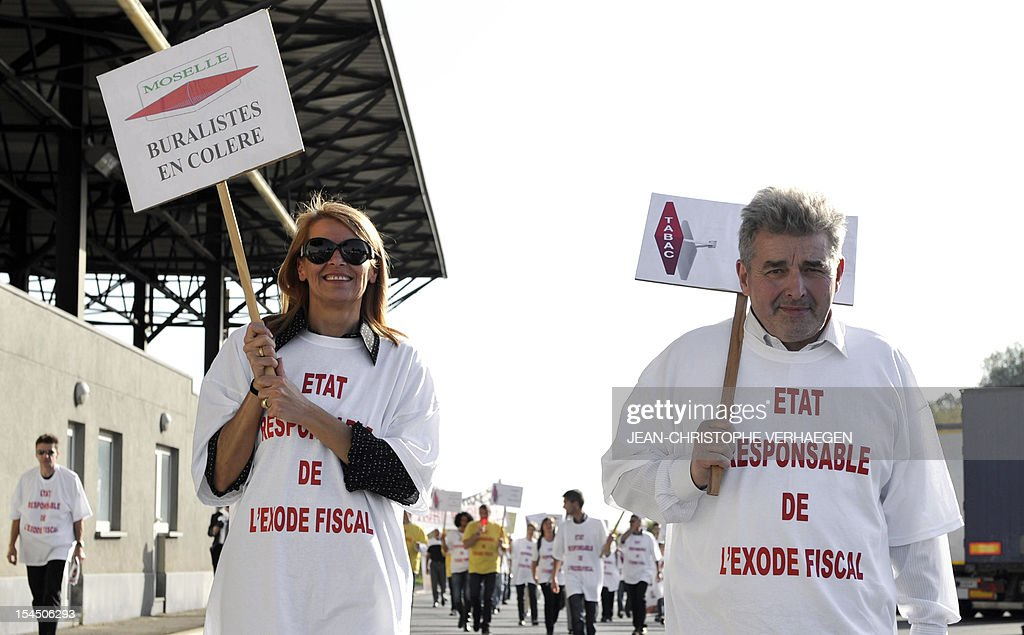 Hundreds of French tobacconists block the access to the border between France and Luxembourg, to protest against a recent price hike on cigarettes and tobacco products in France, on October 21, 2012, in Zoufftgen, eastern France.