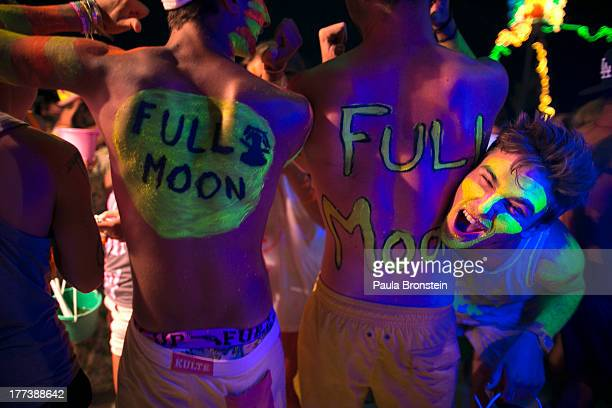 Hundreds of full moon partiers dance the night away on the beach of Haad Rin on August 22 2013 in Koh Phangan Thailand Thousands of people from...