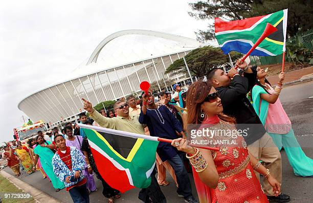 Hundreds of Hindu devotees with flags and vuvuzelas pass the World Cup 2010 FIFA Moses Mabhida football stadium to celebrate the two day Diwali Hindu...