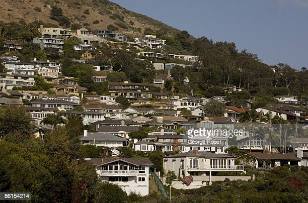Hundreds of homes are packed tightly along the steep ocean bluffs in this scenic seaside community as seen in this 2009 Laguna Beach California...