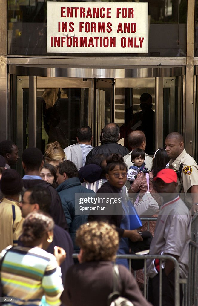 Hundreds of illegal immigrants line up April 30, 2001 in front of the INS office in New York on the last day to apply for green cards before having to leave the country.