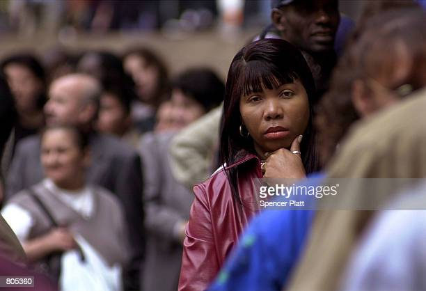 Hundreds of illegal immigrants line up April 30 2001 in front of the INS office in New York on the last day to apply for green cards before having to...