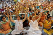 Hundreds of Indians take part in a yoga session as they celebrate �Yoga Shakti Divas � in Amritsar on April 19 2009 Yoga meaning union in Sanskrit is...
