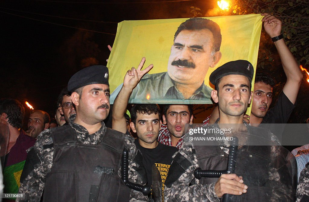 Hundreds of Iraqi Kurds, carrying a portrait of jailed Kurdish rebel leader Abdullah Ocalan who is serving a life sentence in Turkey since 1999, protest in the center of the northern city of Sulaimaniyah on August 22, 2011 to denounce Turkey's latest bombing campaign on Kurdish separatist bases in northern Iraq.