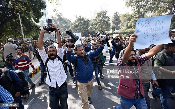 Hundreds of journalists hold a protest march against the attack on media persons covering the hearing of a sedition case of student's Union President...