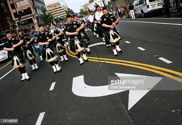 Hundreds of law enforcement bagpipe players march down 6th Street NW during the Twelfth Annual Emerald Society Pipeband March and Service May 14 2007...