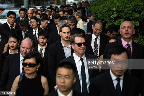 Hundreds of lawyers and representatives from the legal sector dress in black and take part in a silent march from the High Court to the Court of...