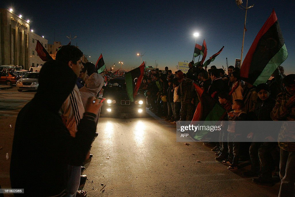 Hundreds of Libyans celebrate the upcoming second anniversary of the Libyan revolution, in Benghazi on February 16, 2013. Libya on Sunday will mark the second anniversary of the uprising that toppled the regime of strongman Moamer Kadhafi, amid fears of fresh violence and calls for demonstrations across the country. The government has already taken a series of measures to contain any attempt by supporters of the former regime to 'sow chaos' amid anger from protesters who accuse the new rulers of failing to push for reform.