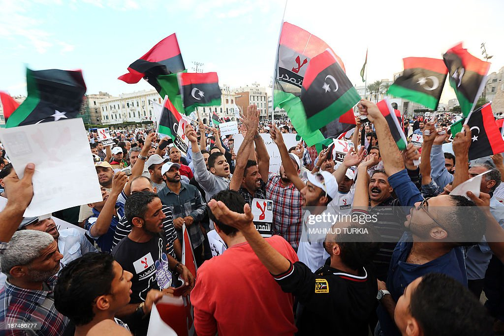 Hundreds of Libyans demonstrate in Tripoli's landmark Martyrs Square on November 9, 2013, to protest against a renewed mandate for the country's top political body, the General National Congress, next year. On its election the GNC was given an 18-month mandate to draft a new constitution and guide Libya towards general elections. But political tension and chronic insecurity have cast doubts over Libya's ability to complete the transition before the GNC's mandate expires in February.