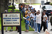 Hundreds of Los Angeles county residents wait to hand deliver their absentee ballots to the Registrar's Office in Norwalk Most voters waited at least...