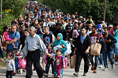 Hundreds of migrants arrive off a train from Roszke at Hegyshalom railway station on the Austrian border after Hungarian authorities closed the open...