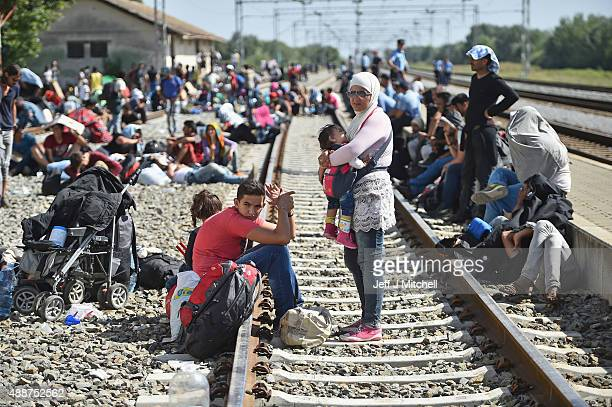 Hundreds of migrants wait at Tovarnik station for a train to take them to Zagreb on September 17 2015 in Tovarnik Croatia Migrants are crossing into...