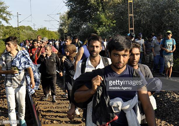 Hundreds of migrants walk toward Austria border after leaving the transit zone of the Budapest main railway station Keleti on September 04 2015 in...