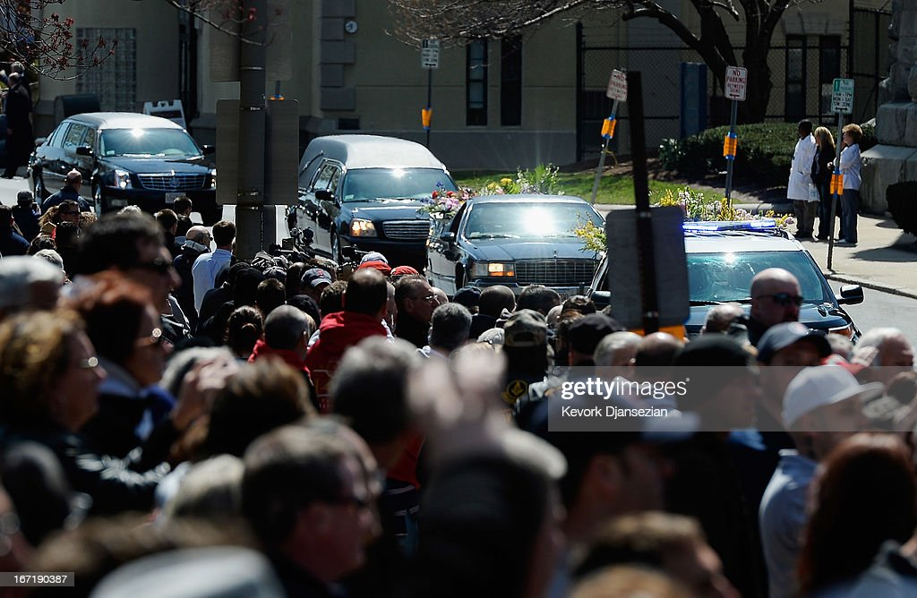 Hundreds of mourners line the street as the hears arrives at St. Joseph Catholic Church for the funeral of Krystle Campbell, a victim of the Boston Marathon bombing, on April 22, 2013 in Medford, Massachusetts. A manhunt ended for Dzhokhar A. Tsarnaev, 19, a suspect in the Boston Marathon bombing after he was apprehended on a boat parked on a residential property in Watertown, Massachusetts. His brother Tamerlan Tsarnaev, 26, the other suspect, was shot and killed after a car chase and shootout with police. The bombing, on April 15 at the finish line of the marathon, killed three people and wounded at least 170.