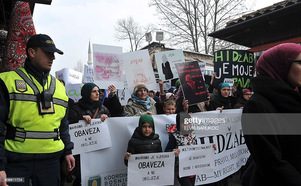 Hundreds of Muslim women wearing the traditional Muslim headscarf also known as hijab protest in Sarajevo's historical center, on February 7, 2016. The protest walk was organized after a decision was made by Bosnia and Herzegovina's High Judicial Committee, that religious manifestations should neither be shown nor displayed, by judges, prosecutors or other personal of the judiciary institutions in the country. / AFP / ELVIS BARUKCIC