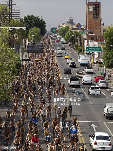 Hundreds of naked cyclists take part in the World Naked Bike Ride to protest against cars gas emissions from cars and agressive drivers in...