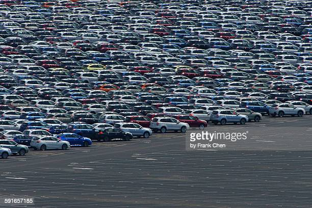Hundreds of new cars neatly parked in parking lot