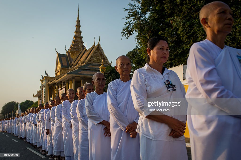 Hundreds of nuns wait in line outside the Royal Palace before being allowed to enter the cremation site to pay their final respects to former King Norodom Sihanouk on February 2, 2013 in Phnom Penh, Cambodia. The former kings coffin was transported to the cremation site yesterday after being paraded through the capital in a lavish funeral procession. The cremation will take place on Monday the 4th of February, the funeral pyre will be lit by his wife and son King Norodom Sihamoni.