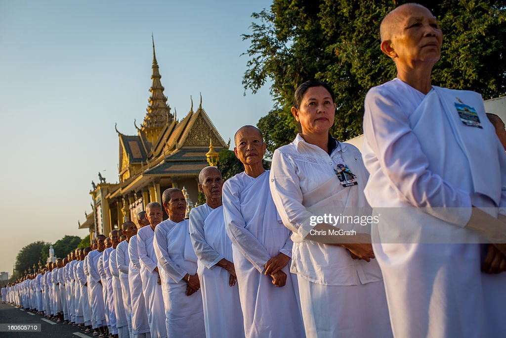 Hundreds of nuns wait in line outside the Royal Palace before entering the cremation site to pay their final respects to former King Norodom Sihanouk on February 2, 2013 in Phnom Penh, Cambodia. The former kings coffin was transported to the cremation site yesterday after being paraded through the capital in a lavish funeral procession. The cremation will take place on Monday the 4th of February, the funeral pyre will be lit by his wife and son King Norodom Sihamoni.