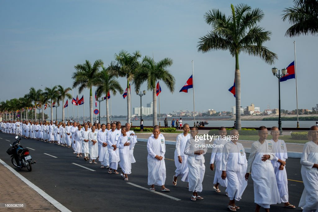 Hundreds of nuns walk down the street after visiting the cremation site to pay their final respects to former King Norodom Sihanouk on February 2, 2013 in Phnom Penh, Cambodia. The former kings coffin was transported to the cremation site yesterday after being paraded through the capital in a lavish funeral procession. The cremation will take place on Monday the 4th of February, the funeral pyre will be lit by his wife and son King Norodom Sihamoni.