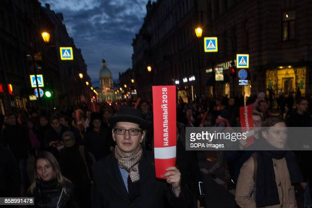 Hundreds of opposition supporters are seen participating in an unauthorized rally The President of Russia Vladimir Putin celebrated his 65th birthday...