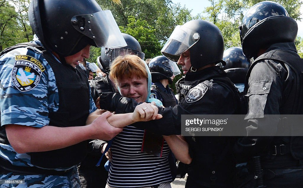 Hundreds of Orthodox believers clash with police to prevent Gay Parade in Kiev on May 25, 2013. Around a hundred gay rights activists marched in Ukraine on Saturday despite fears of violence and a court ban, the post-Soviet country's first ever gay pride event.