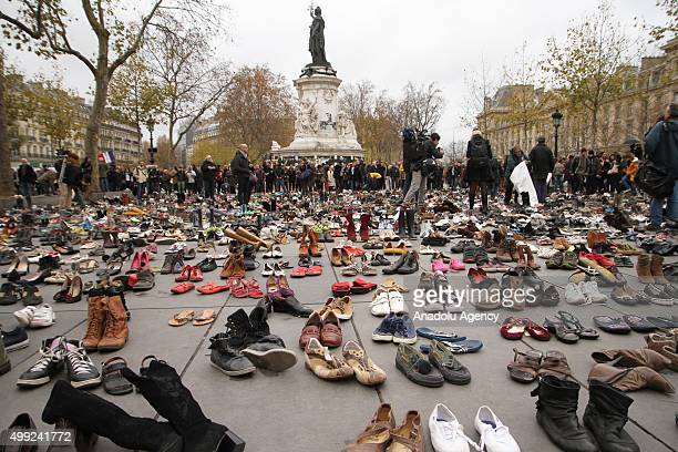 Hundreds of pairs of shoes are displayed at Republique Square during a demonstration ahead of the UN climate change conference in Paris France on...