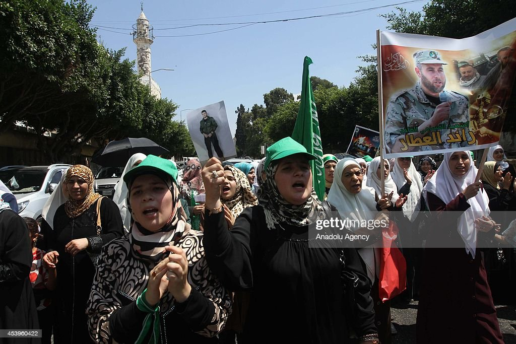 Hundreds of Palestinians chant slogans during a solidarity demonstration to support Hamas carrying Hamas flags and to protest ongoing Israeli army's offensives in Gaza Strip, after Friday Prayer in Nablus, West Bank on August 22, 2014.