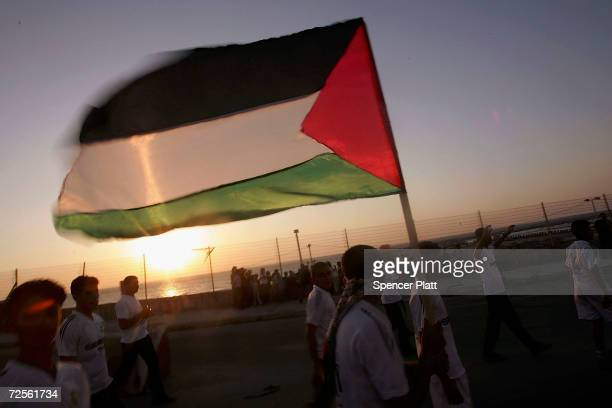 Hundreds of Palestinians wave flags and celebrate at a Fatah rally on August 15 2005 in Gaza City Palestinians rejoiced today as Israeli officially...