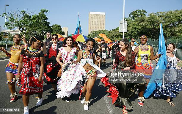 Hundreds of people adorned with traditional regalia from different cultures march through the streets of Durban on May 23 2015 as the annual...