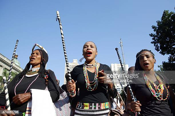 Hundreds of people adorned with traditional regalia march through the streets of Durban to celebrate Africa Day on May 23 2015 as the annual...