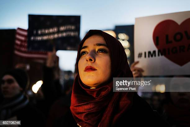 Hundreds of people attend an evening rally at Washington Square Park in support of Muslims immigrants and against the building of a wall along the...