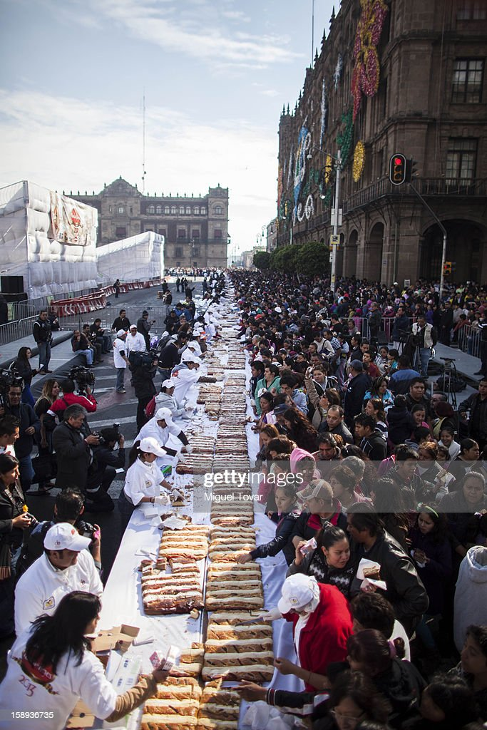 Hundreds of people attends the giant Three Kings bread celebration at the Capital Square on January 03, 2013 in the Mexico City, Mexico. The gigant bread had 720 meters long and 9375 weight and was divided among the 25000 people who attended the event