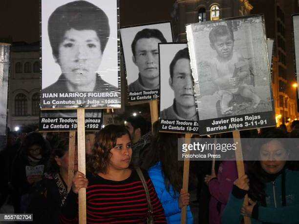 Hundreds of people carrying portraits of their missing relatives took to the streets of Lima in protest of a possible pardon to former President...