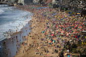 Hundreds of people enjoy the Renaca beach in Vina del Mar on January 24 2009 Solar radiation the principal cause of the skin cancer has made the...