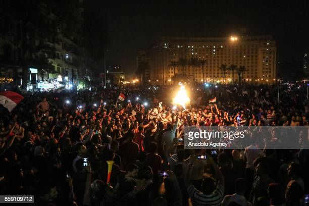 Hundreds of people gather at Tahrir Square during celebrations after Egypt beats Congo during the FIFA 2018 World Cup Qualifiers match and gain right...