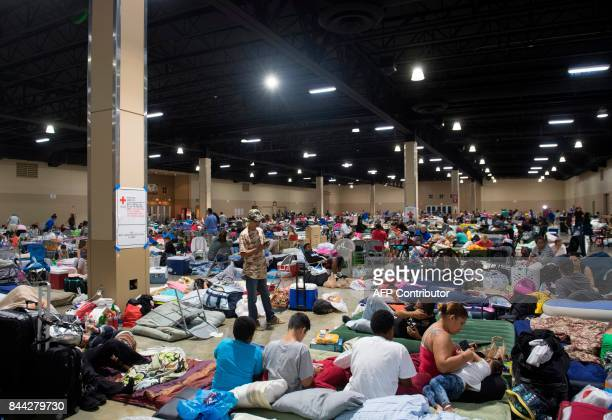 Hundreds of people gather in an emergency shelter at the MiamiDade County Fair Expo Center in Miami Florida September 8 ahead of Hurricane Irma...