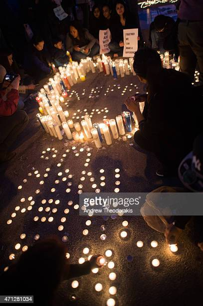 Hundreds of people gather in Diversity Square to light candles during a vigil for the victims of the earthquake in Nepal on April 26 2015 in the...