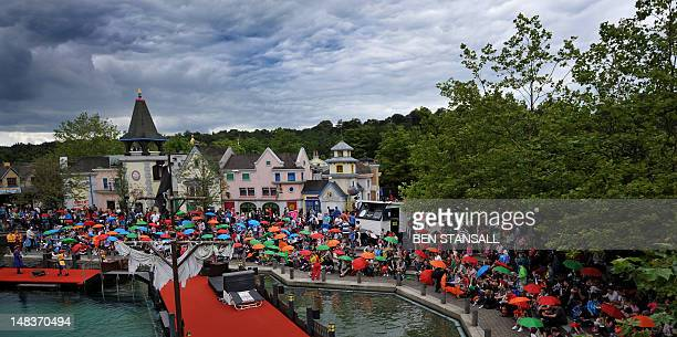 Hundreds of people gather July 15 with umbrellas for a singalong of the nursery rhyme 'Rain Rain Go Away' during a photocall at Legoland in Windsor...