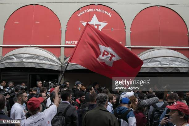 Hundreds of people gather to accompany former Brazilian President Luiz Inacio Lula da Silva in his statement to the press at the headquarters of the...