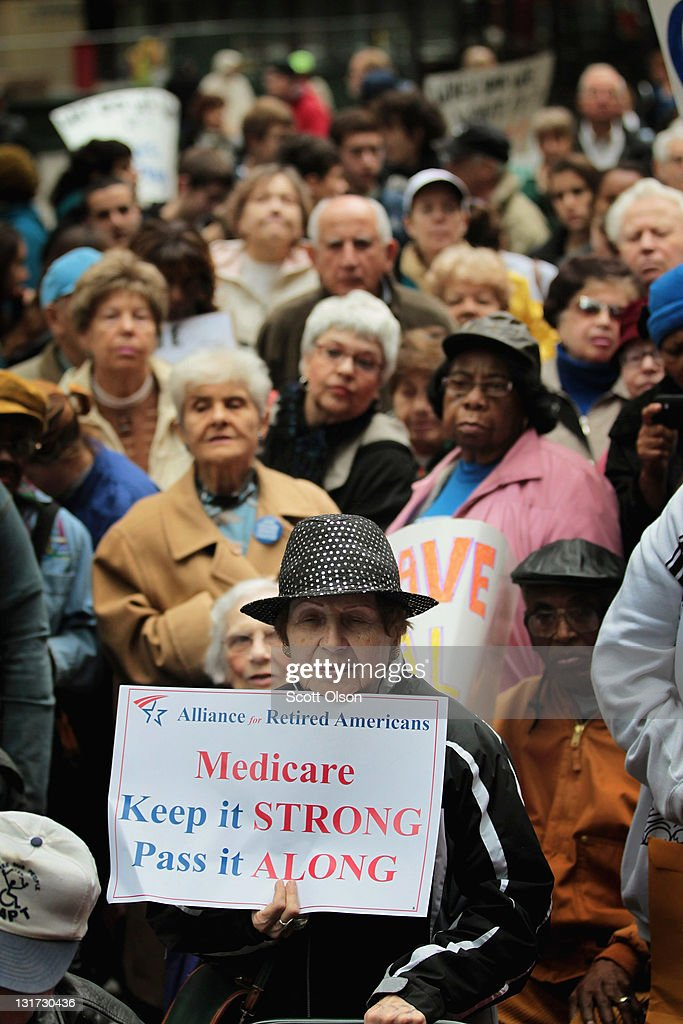 Hundreds of people including many senior citizens gather in Federal Plaza to protest against cuts to federal safety net programs including Social...