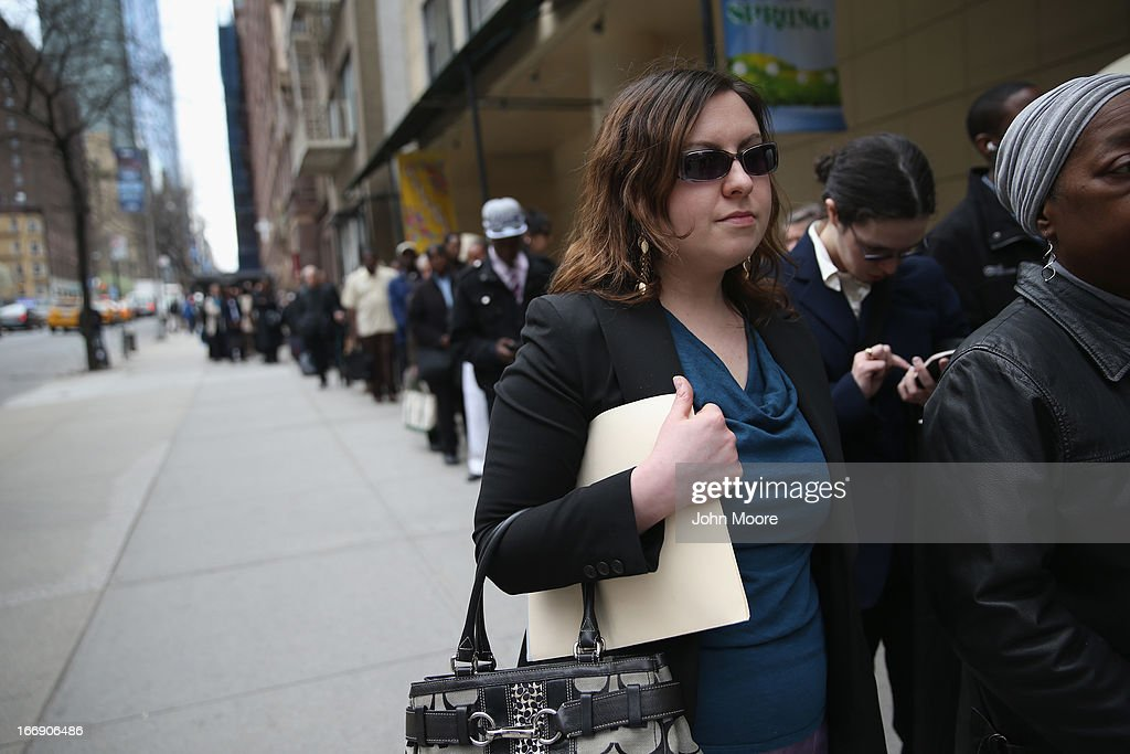 Hundreds of people line up to attend a job fair on April 18, 2013 at the Holiday Inn in Midtown in New York City. The event was held by National Career Fairs which expected some 700 job seekers would come to meet 20 potential employers.