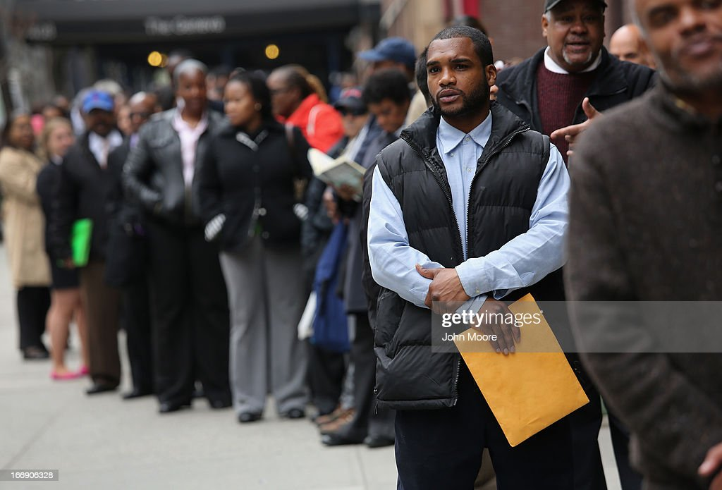Hundreds of people line up to attend a job fair on April 18, 2013 in New York City. The event was held by National Career Fairs which expected some 700 job seekers would come to meet 20 potential employers.